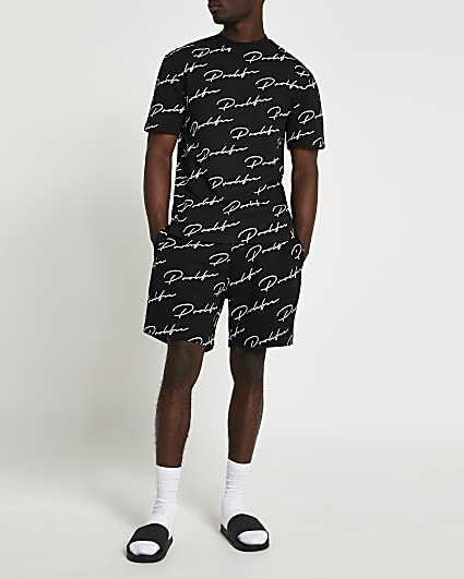 Prolific black monogram shorts