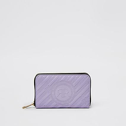 Purple embossed small zip around purse