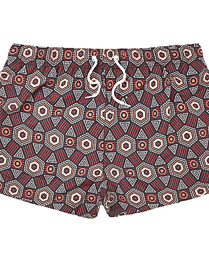 Red abstract print swim shorts
