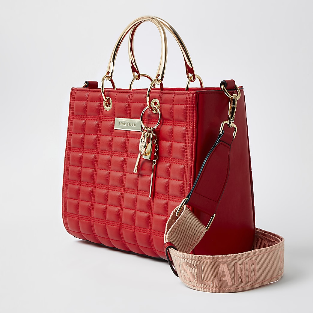 Red boxy quilted tote handbag