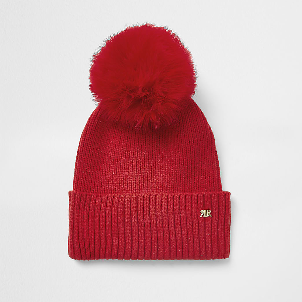 Red faux fur pom pom beanie hat