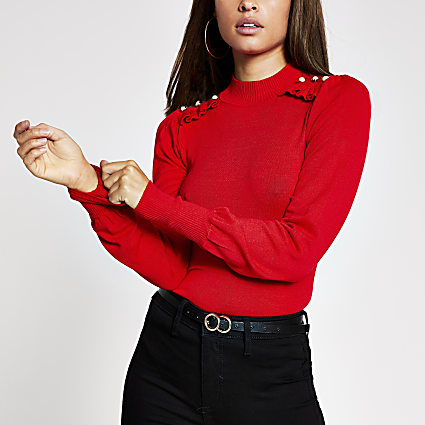 Red frill pearl button turtle neck top