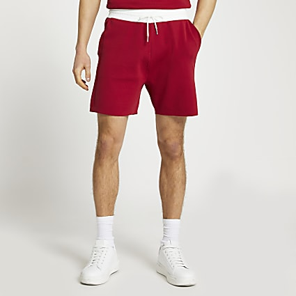 Red knit elasticated contrast waist shorts