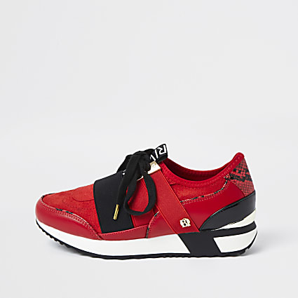 Red lace up runner trainers