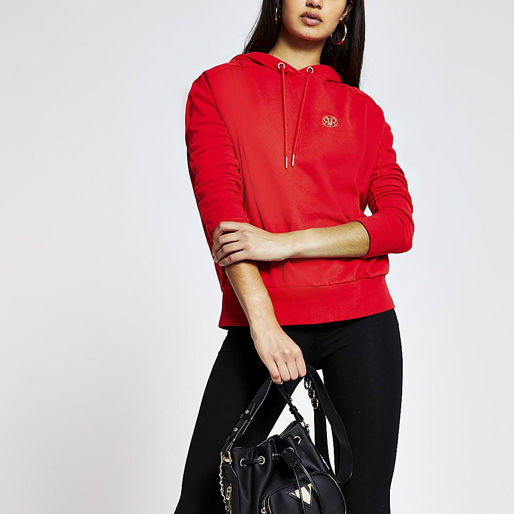 Red long sleeve exposed seam hoodie