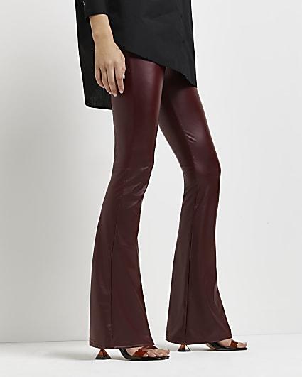 Red matt coated flared trousers