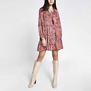 Rode gesmokte mini-jurk met print en lange mouwen