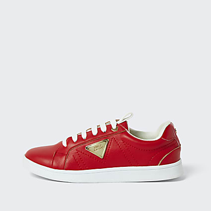 Red side plate lace up trainers