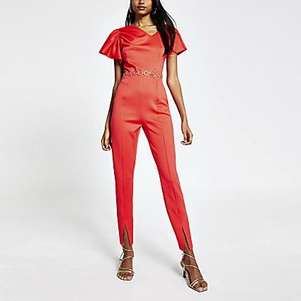 Red sleeveless tapered leg jumpsuit