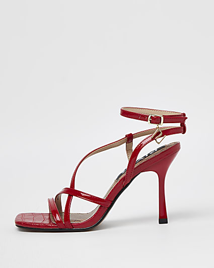 Red strappy heeled sandals
