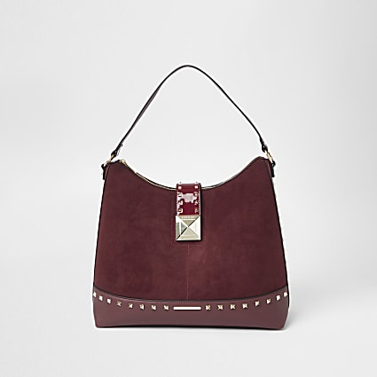 Red studded padlock slouch handbag