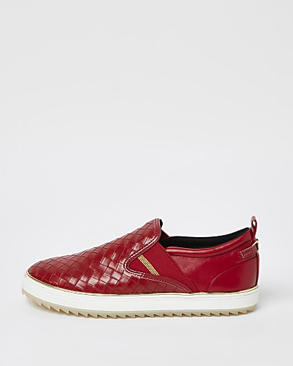 Red woven trainers