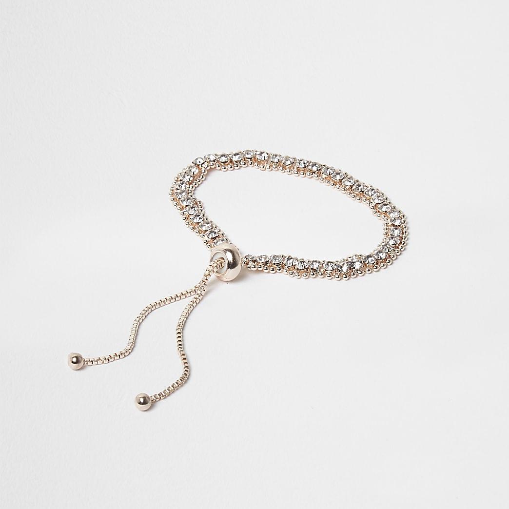 Bracelet lasso façon or rose à strass