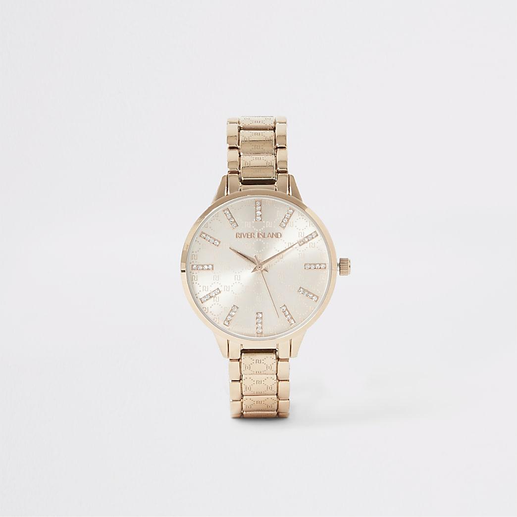 Goudkleurig horloge met bandje met siersteentjes en RI-print