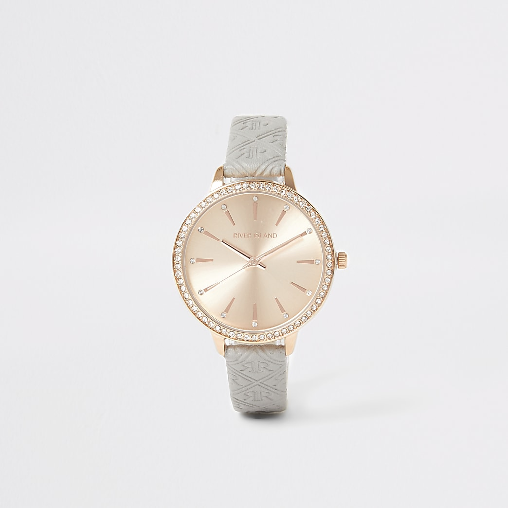 Rose gold colour RI embossed watch