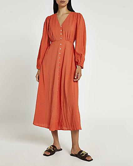 Rust long sleeve button down midi dress