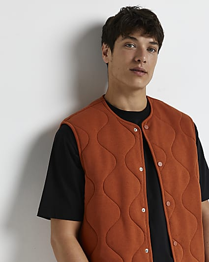 Rust quilted popper fastening gilet