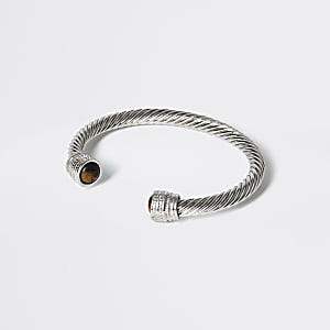 Zilverkleurige stevige gedraaide brede armband