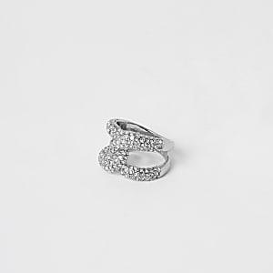 Silberfarbener, mit Strasssteinchen verzierter Ring