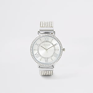 Silberfarbene Armbanduhr mit Strassbesatz