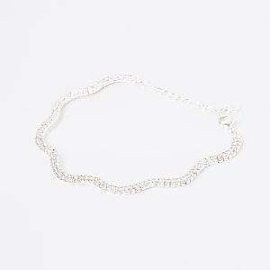 Zilverkleurig golvend enkelbandje met siersteentjes