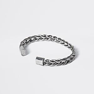 Zilverkleurige gevlochten brede armband