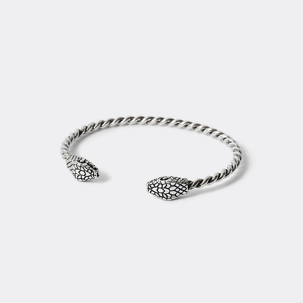 Zilverkleurige gedraaide brede armband met slangenprint