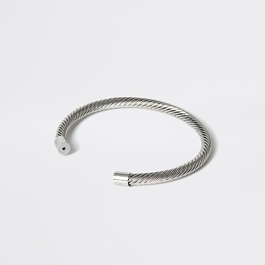 Zilverkleurige gedraaide brede armband