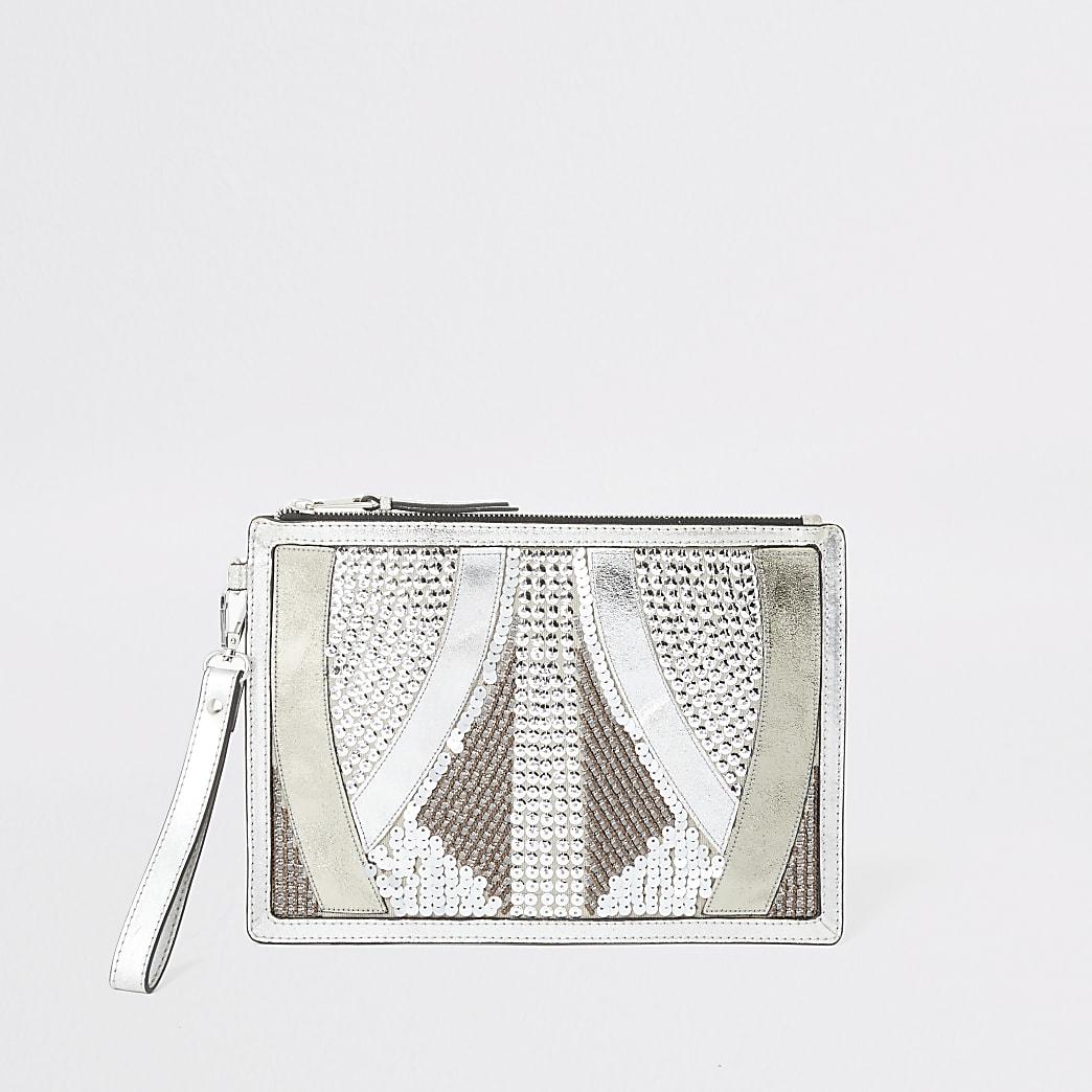 Zilverkleurige leren verfraaide clutch handtas