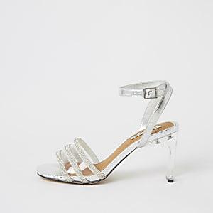 Zilverkleurige metallic perspex sandalen met hak en siersteentjes