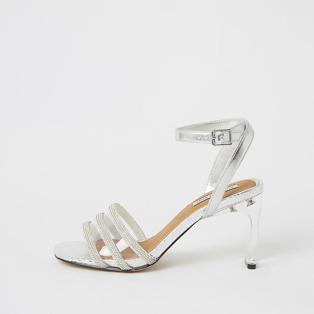 Sandales argentées métallisées à talon perspexà strass
