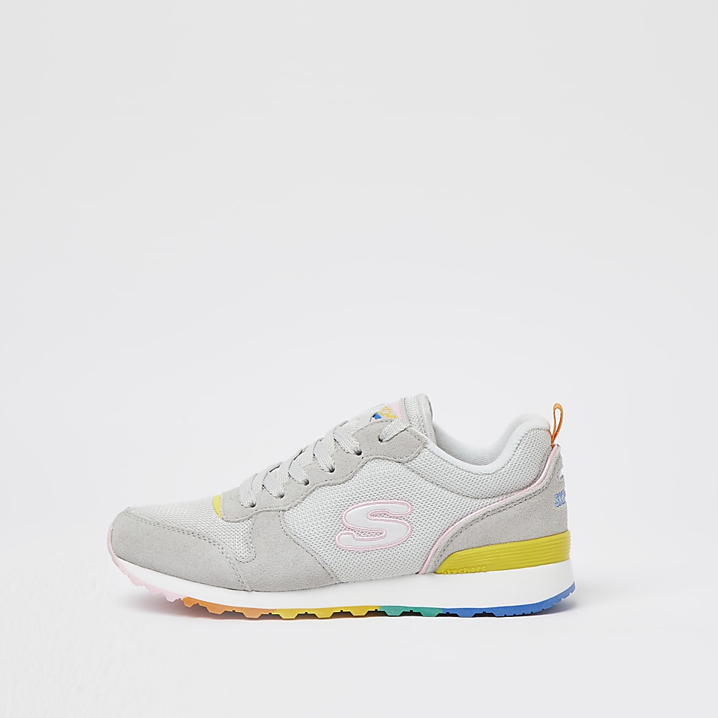 Sketchers white lace up trainers
