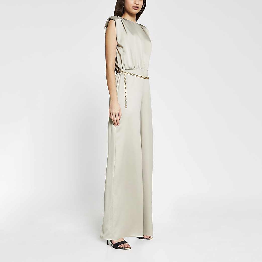 Stone shoulder pad chain belted jumpsuit