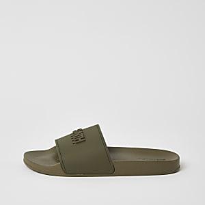 Kaki SVNTH slippers met reliëf