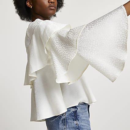 White animal print ruffle blouse top