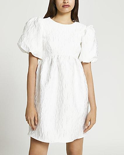 White bow back textured mini dress