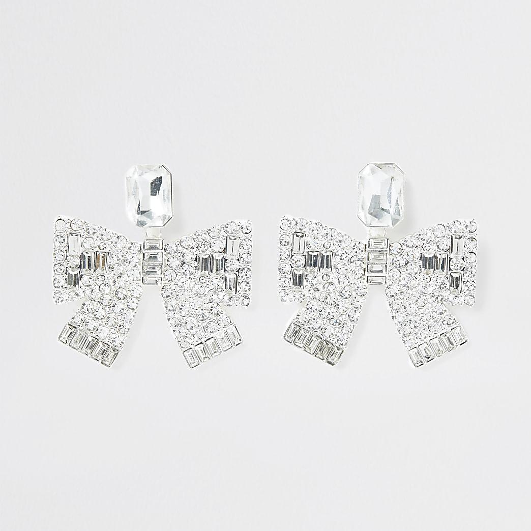 White bow drop diamante earrings