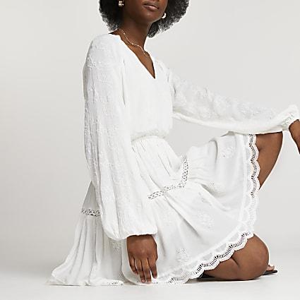White broderie long sleeve mini dress
