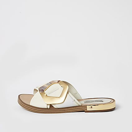 White buckle cross over strap sandals