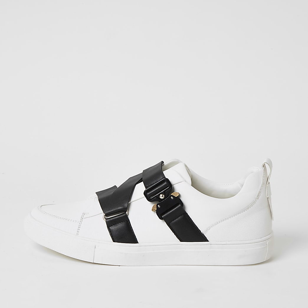 White buckle strap trainers