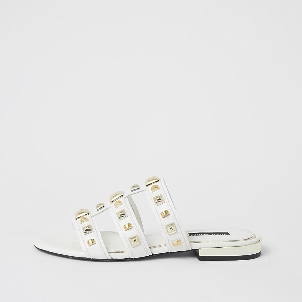 Sandales plates cloutées effet cage blanches