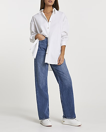 White cinched in oversized shirt