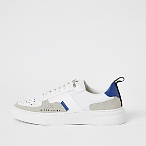 Witte sneakersmet kleurvlakken en vetersluiting