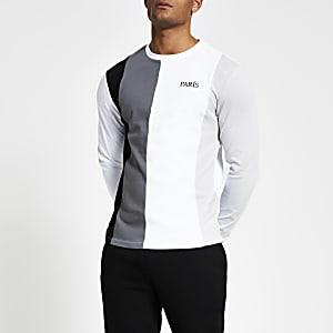 Wit T-shirt met lange mouwen en kleurvlakken