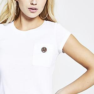 Wit T-shirt met ronde zoom en RI-embleem met siersteentjes