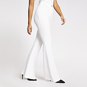 White diamante button flare leg trousers