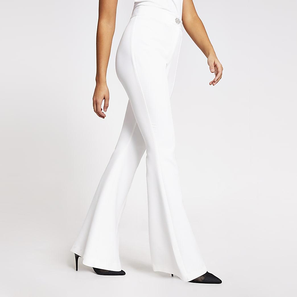 White diamante button flare leg trousers