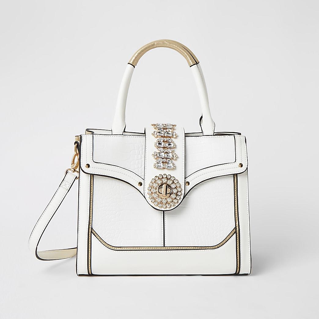 Witte handtas met verfraaid slotje voor