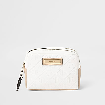 White embossed make-up bag