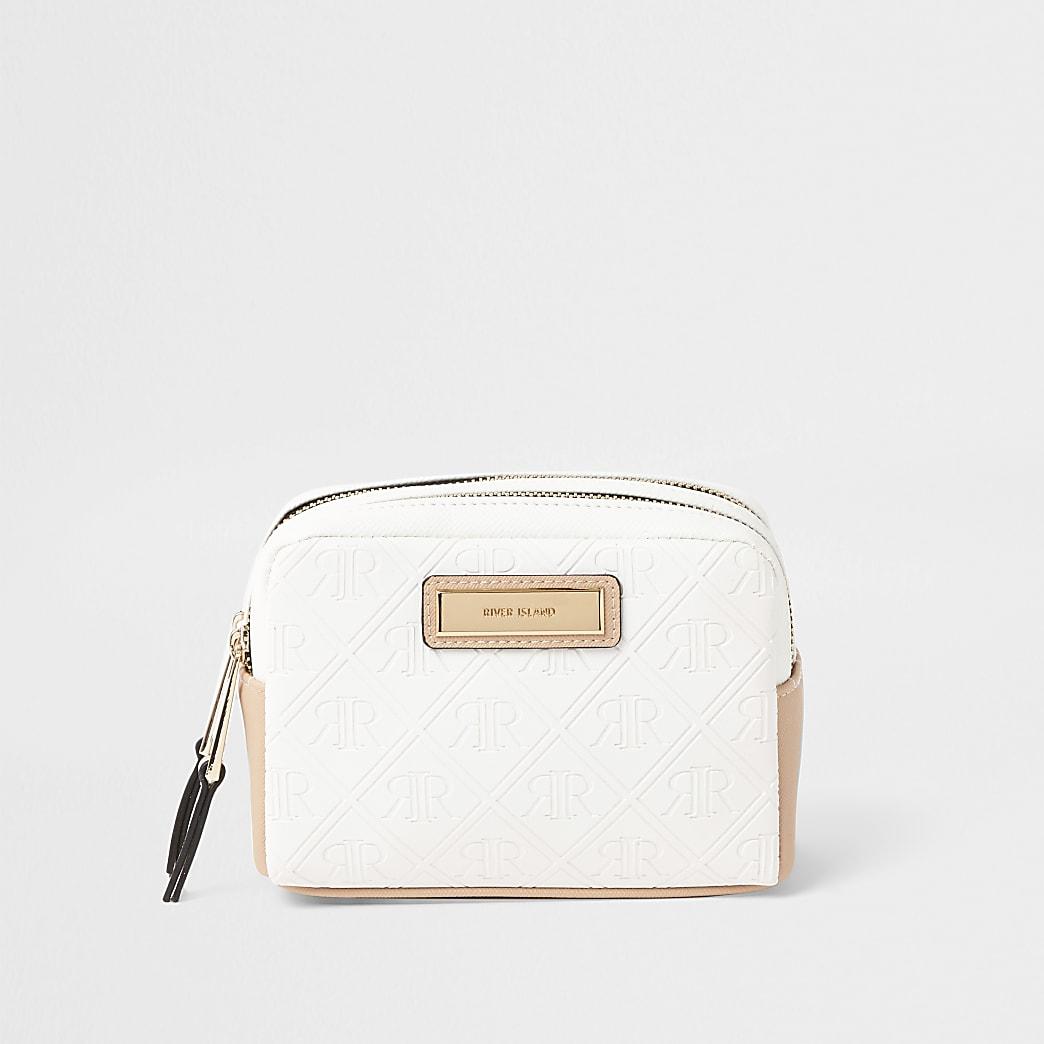 White embossed make-up bag